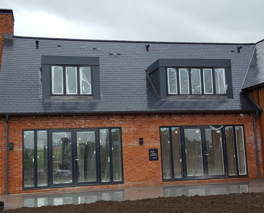 Dormer roof and cladding